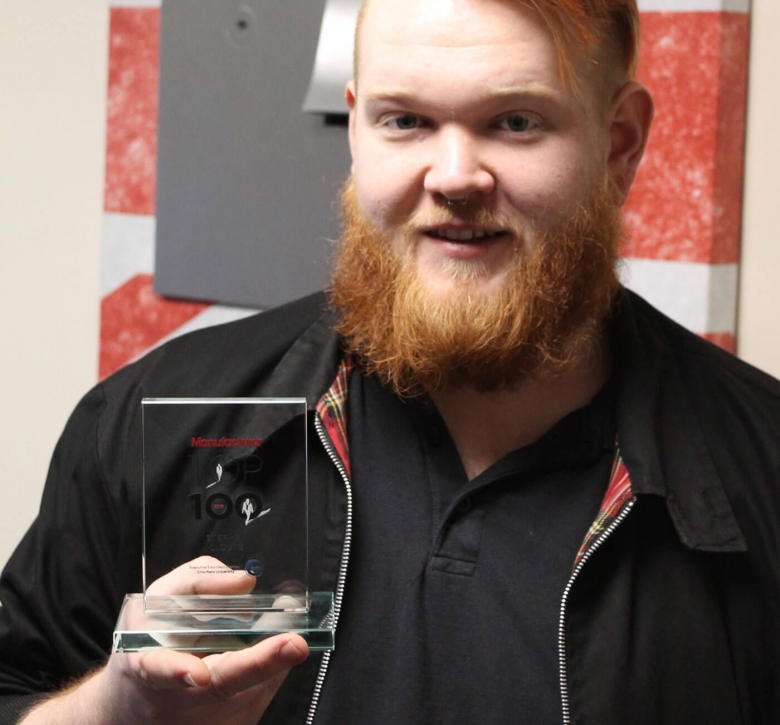 Stephen Cloute, Young Pioneer winner with his Top 100 Award trophy.