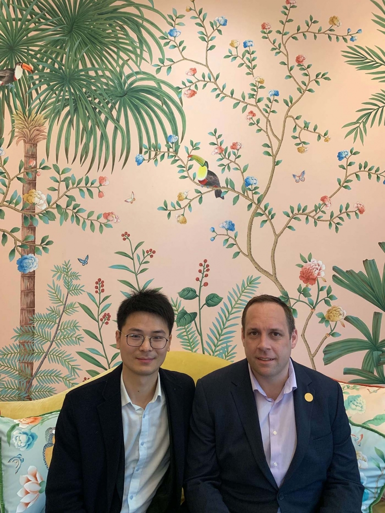 Richard Song de Gournay director China (left), Duncan Ray Focus SB head of strategic relationships (right) pictured with hand painted Amazonia Chinoiserie wallpaper on Florence Pink Dyed Silk.